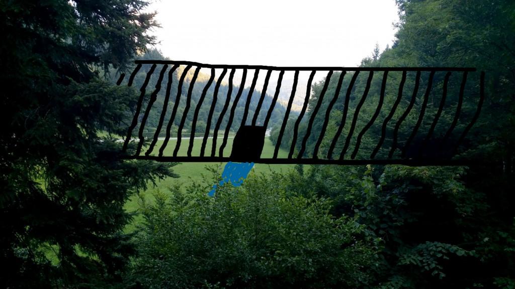 Visualisierung der 15 m hohen Staumauer: Blick von einem der Häuser in Güterstal Richtung Schauinsland, der durch die Staumauer komplett verdeckt würde (Foto: M. Managò).