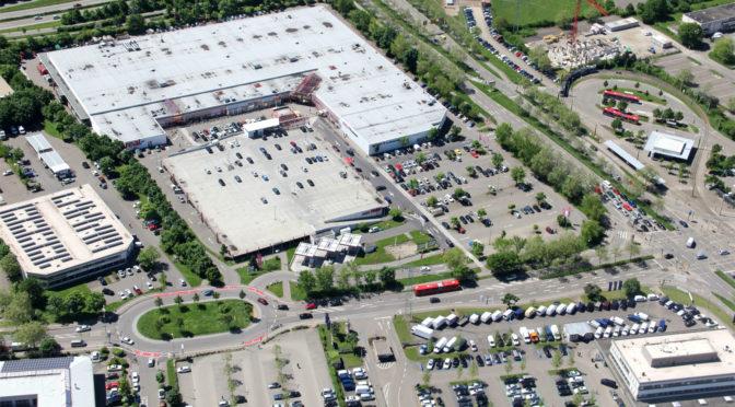 Wohnen über Parkplätzen und Supermärkten